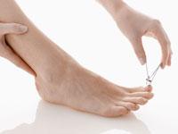 Woman cutting toenails