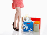 Woman standing by shopping bags