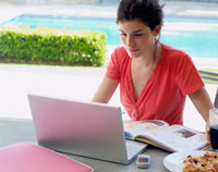Woman studying and using laptop,