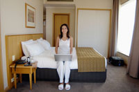 Woman with laptop in hotel room