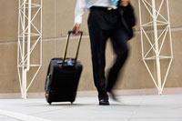 Businessman pulling briefcase