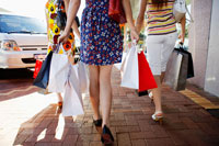 Teenage girls carrying shopping bags