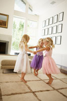 Triplets dancing in living room