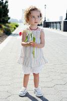 Girl holding tulip