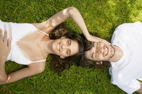 Young couple lying on lawn