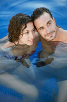 Portrait of mid adult couple in water