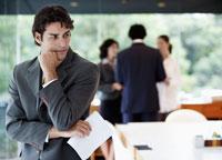 Businessman thinking in boardroom