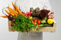 Chef holding box of vegetables