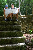 Mid adult couple reading map at ruins