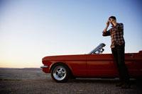 Man photographing at sunset 11021005205| 写真素材・ストックフォト・画像・イラスト素材|アマナイメージズ