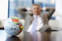 Businessman near globe