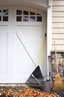 Gardening equipment by garage door