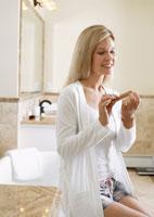 Mature woman filing nails