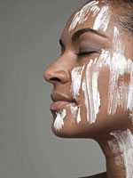 Moisturizer on young womans face
