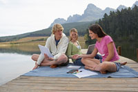 Three Teenagers Studying at Lake