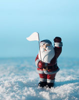 Santa Claus Figurine in Snow