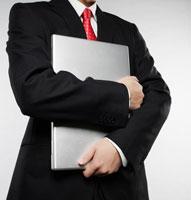 Businessman Holding Laptop 11021006414| 写真素材・ストックフォト・画像・イラスト素材|アマナイメージズ