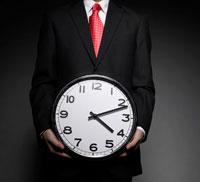 Businessman Holding Clock 11021006436| 写真素材・ストックフォト・画像・イラスト素材|アマナイメージズ