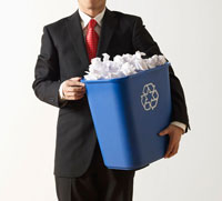 Businessman Holding Recycling Paper Bin