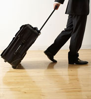 Businessman Pulling Wheeled Suitcase