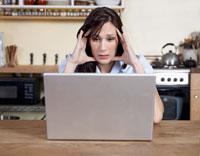 Worried Woman Using Laptop