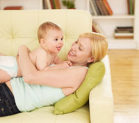 Mother and Baby Boy on Sofa