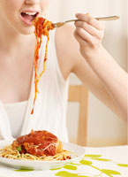 Midsection of Woman Eating Spaghetti