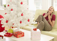 Woman Laughing near Christmas Tree