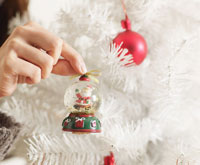 Hand Decorating Christmas Tree