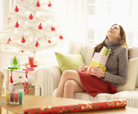 Woman with Stack of Christmas Presents