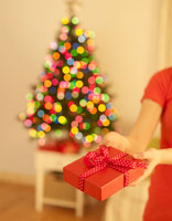 Woman Giving Christmas Present