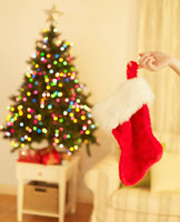 Woman's Hand Holding Christmas Stocking