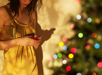 Woman Text Messaging at Christmas