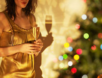 Woman Drinking Champagne at Christmas