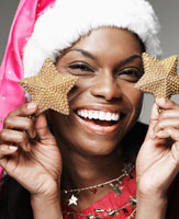 Woman Holding Decorative Christmas Stars