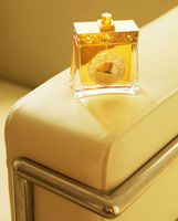 Perfume Bottle on Armchair