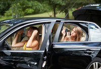Teenage Girls Applying Make-Up in Car