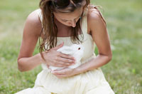 Mid-Adult Woman Holding White Rabbit