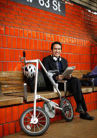 Businessman Commuting by Bike and Subway