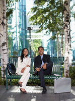Portrait of Two Businesspeople on Park Bench