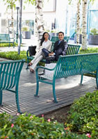 Two Businesspeople on Park Bench