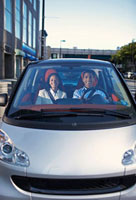 Mid-Adult Couple Driving Smart Car