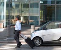 Businessman Walking by Smart Car