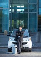 Businessman Beside Smart Car