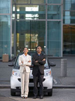 Two Businesspeople Beside Smart Car