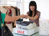 Sales Clerk Receiving Payment