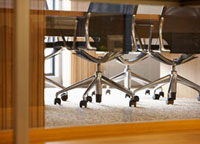 Close-Up of Office Chairs by Conference Table