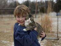 Portrait of Boy Holding Cat
