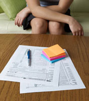 Woman Filling Tax Forms