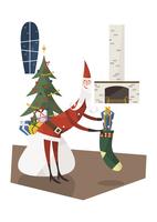 靴下にプレゼントを入れるサンタ 11023012317| 写真素材・ストックフォト・画像・イラスト素材|アマナイメージズ